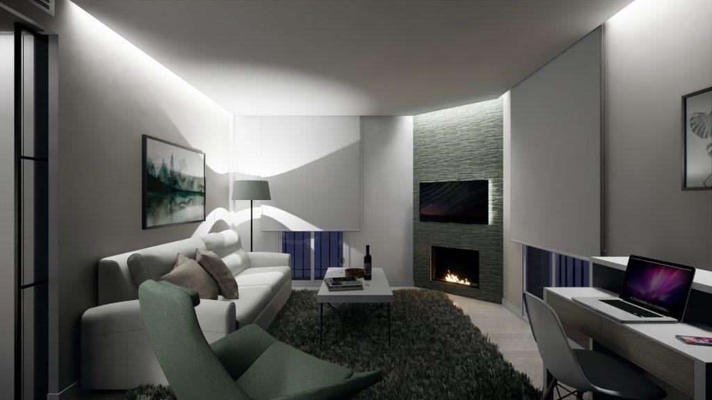 proyecto interiorismo reforma y decoración de vivienda en calle gerona malaga – 6 – salon noche chimenea sofa cortinas fosa ordenador